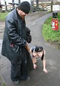 Pale gothic slut treated as a dog in a public bridge.
