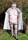 Fat granny posing nude in a park.