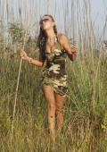 Slim beauty in army dress gets nude