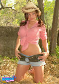 Karen in tiny jeanshorts and a cowgirl hat.
