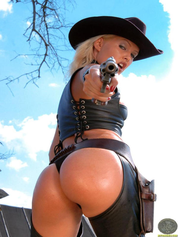 Cowgirl  posing with old six shooter