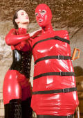 Teen slave wrapped in latex.