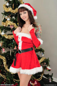 Cute teenl Ivy Snow posing as Santa girl 1