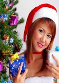 Asian x-mas babe under the tree